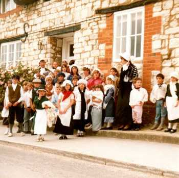 Children in 18C costume outside the Chapel Lane House which became the venue for Stock's School when the Church got too small